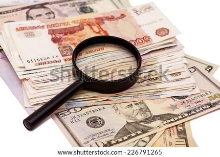 Money under magnifying glass  - stock photo
