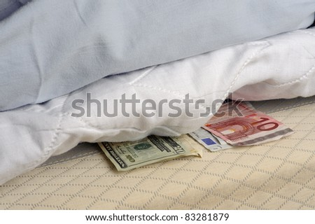 Money under the mattress - stock photo