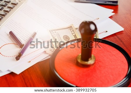 Money under the notary public stamper. Bribe, corruption concept.  - stock photo