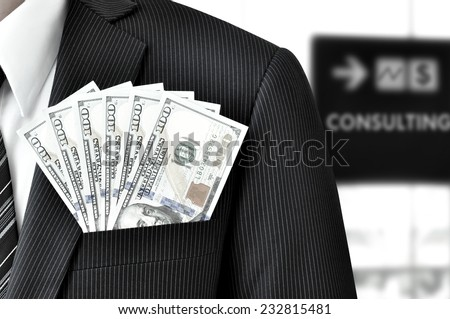 Money - United States dollar (or USD) bills in businessman pocket - financial consulting concept - stock photo