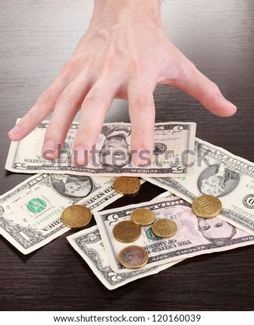 Money, which take hands on wooden table background - stock photo