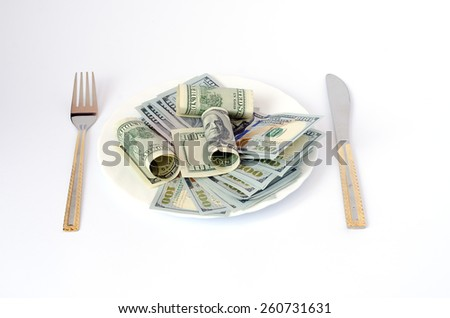 money with dollar currency cutlery on a plate fork knife on a white background - stock photo