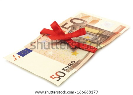 Money with red bow on a white background - stock photo