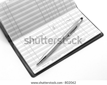 Money withdrawl in a checking account register - stock photo