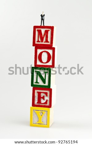 Money word and toy business man - stock photo