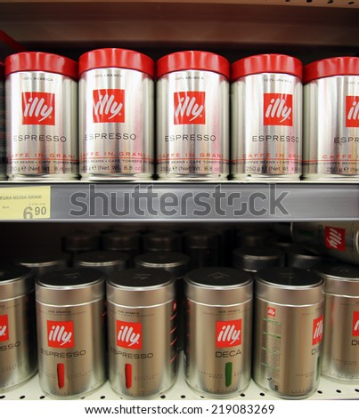 MONFALCONE, ITALY - AUG 17, 2014: Ily coffee on display on the shelf of a market in Monfalcone, Italy, on August 17, 2014.Illycaffe is an Italian company specializes on the production of espresso - stock photo
