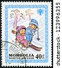 MONGOLIA - CIRCA 1980: A stamp printed by Mongolia, shows Children Skiing and Sledging, circa 1980 - stock photo