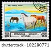 MONGOLIA-CIRCA 1982: A stamp printed by Mongolia, shows horses in the river, circa 1982 - stock photo