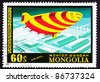 MONGOLIA - CIRCA 1977:  A stamp printed in Mongolia shows a futuristic flying wedge dirigible which means it had a ridged shape but was full of helium, circa 1977. - stock photo