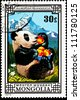 MONGOLIA - CIRCA 1974:  A stamp printed in Mongolia shows a Giant Panda, Ailuropoda melanoleuca, eating a bowl of peaches in a mountain field, circa 1974. - stock photo