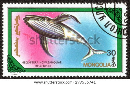 "MONGOLIA - CIRCA 1990: A stamp printed in Mongolia shows a series of images of ""Whales and dolphins"", circa 1990"