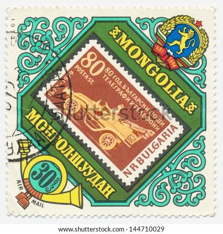 MONGOLIA - CIRCA 1973: A stamp printed in Mongolia shows Bulgarian stamp with a retro car, circa 1973 - stock photo