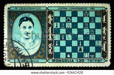 MONGOLIA - CIRCA 1986: A stamp printed in Mongolia shows Chess world chempion Maya Chiburdanidze, circa 1986 - stock photo