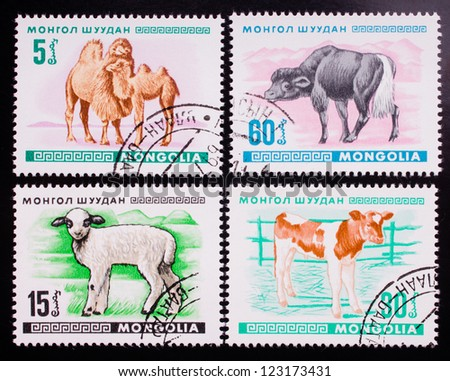 MONGOLIA - CIRCA 1968: A stamp printed in Mongolia shows four kinds of wild and home animals , circa 1968. - stock photo