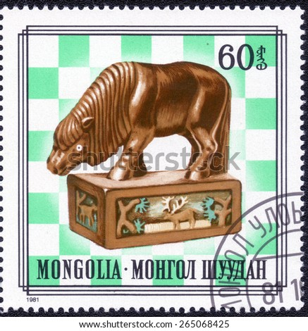 """MONGOLIA - CIRCA 1981: A stamp printed in MONGOLIA shows  from series """"Japanese netsuke"""", circa 1981 - stock photo"""
