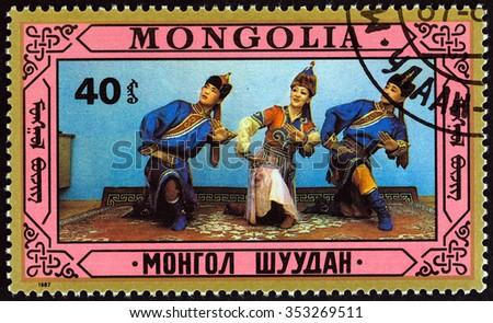 MONGOLIA - CIRCA 1987: A stamp printed in Mongolia shows traditional dance, circa 1987.  - stock photo