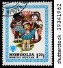 MONGOLIA - CIRCA 1980: A stamp printed in Mongolia shows various ethnic group girls, circa 1980. - stock photo