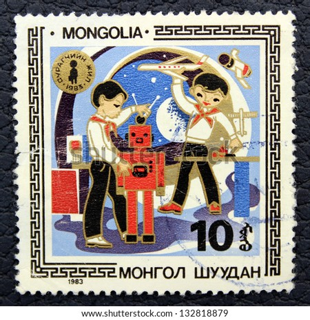 MONGOLIA - CIRCA 1983: A stamp printed in the Mongolia, shows  schoolboys making robots, circa 1983