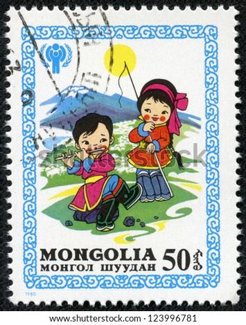 MONGOLIA - CIRCA 1980: stamp printed by Mongolia, shows Children Pasturing Sheep, circa 1980 - stock photo