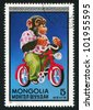 MONGOLIA - CIRCA 1973: stamp printed by Mongolia, shows Chimpanzee on bicycle, circa 1973 - stock photo