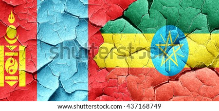 Mongolia flag with Ethiopia flag on a grunge cracked wall - stock photo