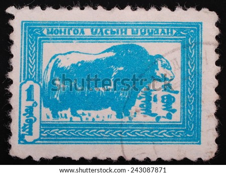Mongolia Shuudan - Circa 1957: Postage stamp printed in Mongolia slaked shows image of a buffalo in blue on a white background - stock photo
