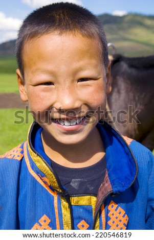 Mongolian boy with a beautiful smile.  - stock photo