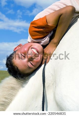 Mongolian boy with his horse.  - stock photo