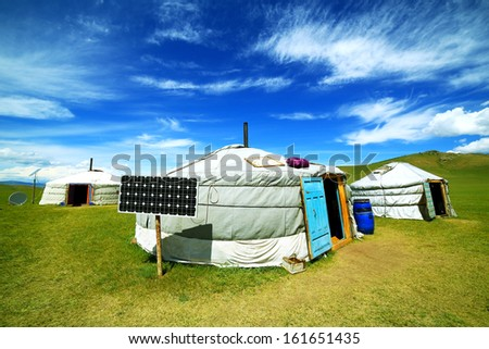 Mongolian ger camps with solar power, TV satellite and oxcart, Central Mongolia. Great contrast, modern and traditional lifestyle melting each other - stock photo