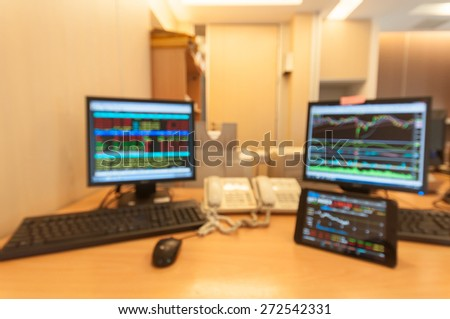 Monitor computer and monitor tablet stock market analysis for stock trading.Blur for background. - stock photo