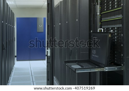 monitor console and server in data center - stock photo