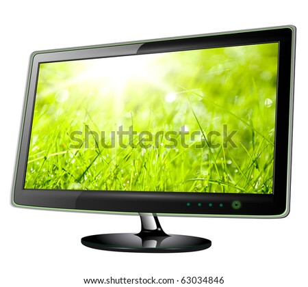 Monitor lcd, tv with green grass on screen. - stock photo