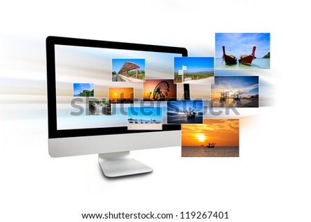Monitor of computer with travel photos isolated on white background