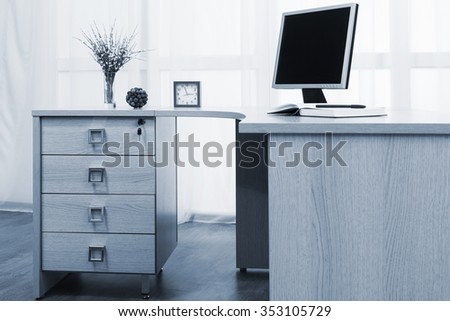 monitor on desk in a modern office - stock photo