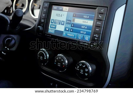 Monitor on the dashboard of the car in FM receiver - stock photo