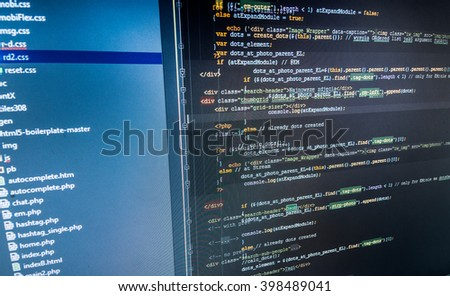 Monitor photo. Developer working on software codes in office. Website development.  Web site codes on computer monitor. Abstract screen of software. Developer working on program codes in office.   - stock photo