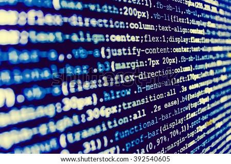 Monitor photo. Source code photo. Website development. Developer working on program codes in office. Computer program. Programmer workplace.  Programming code. Software source code.   - stock photo