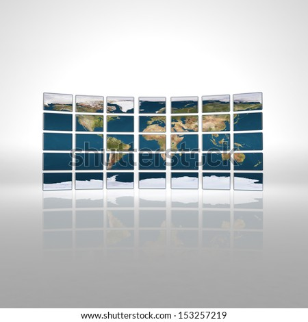Monitor wall with earth map - stock photo