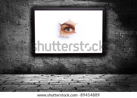 monitor with a picture in which the eye on a gray background - stock photo