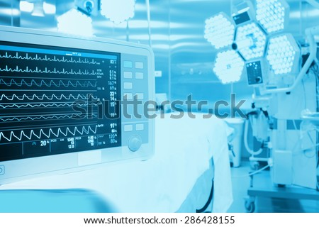 Monitoring of patient in surgical operating room in modern hospital - stock photo