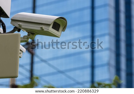 Monitoring security camera The backdrop of the blue blur building. - stock photo