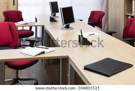 monitors on the desks - stock photo