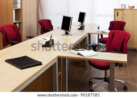 monitors on the desks in a modern office - stock photo