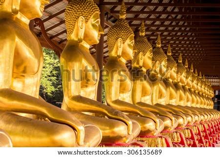 Monk golden image of Buddha - stock photo