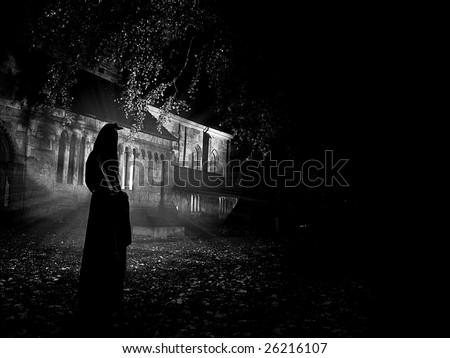 Monk in the church yard - stock photo