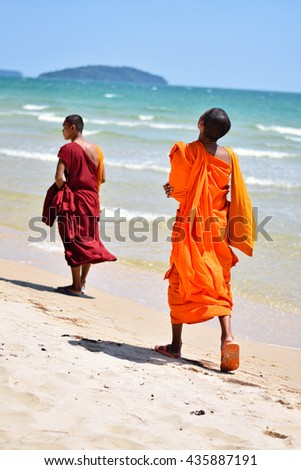 Monk's On The Beach In Cambodia  Sihanoukville, Cambodia - April 19, 2016: Two monks walking by the sea in Cambodia, Sihanoukville. Shoot in Otres beach, in April, Cambodia.