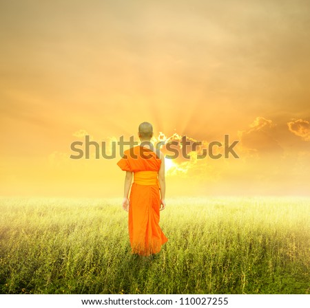 Monk Walk in grass fields and sunset - stock photo