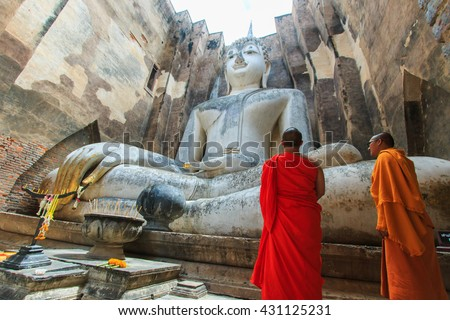 "Monk with Buddha images""Phra achana""  in Wat Si Chum at Sukhothai historical Park,Thailand-28 may, 2016. - stock photo"