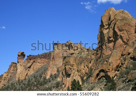 monkey face rock formation on the back side at Smith Rock State Park, Oregon - stock photo
