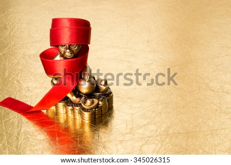 Monkey is a symbol of the chinese new year 2016, and red ribbon on a gold background - stock photo